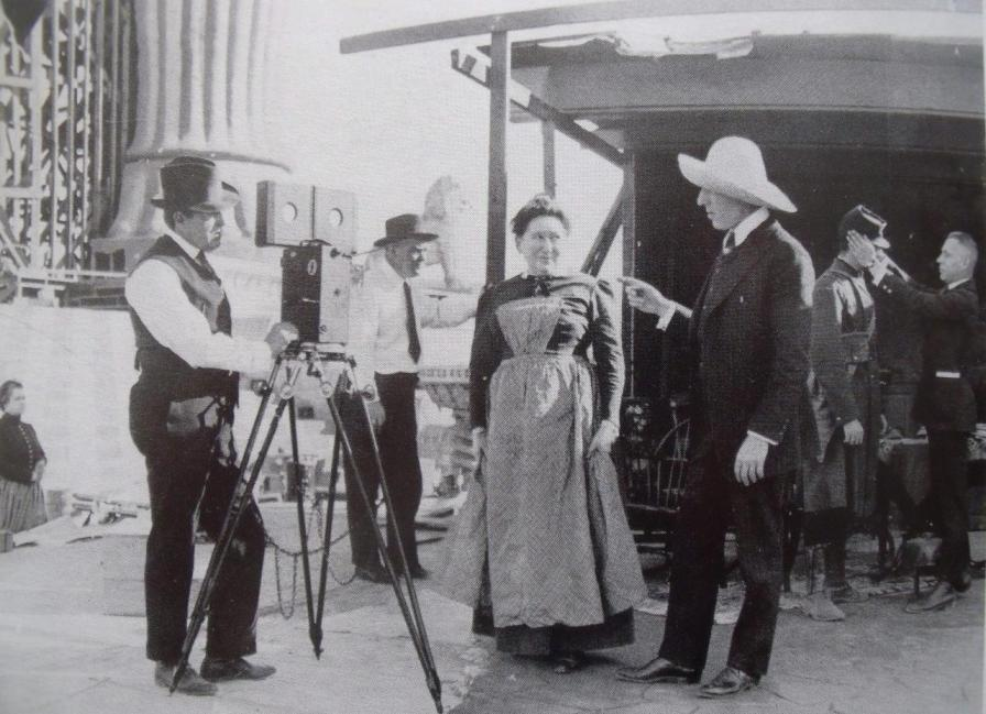 Billy-Bitzer-cinematographer-and-Josephine-Crowell-and-Griffith-and-Stroheim-ajusting-soldiers-cap-intolerance