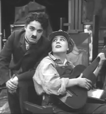 Charlie-Chaplin-and-Edna-Purviance-in-Behind-the-Screen-1916-100a