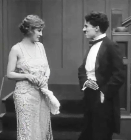 Edna-Purviance-and-Charlie-Chaplin-in-The-Adventurer-1917-100a