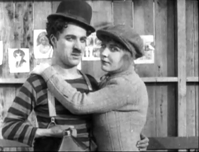 Edna-Purviance-and-Charlie-Chaplin-in-The-Champion-1915-8