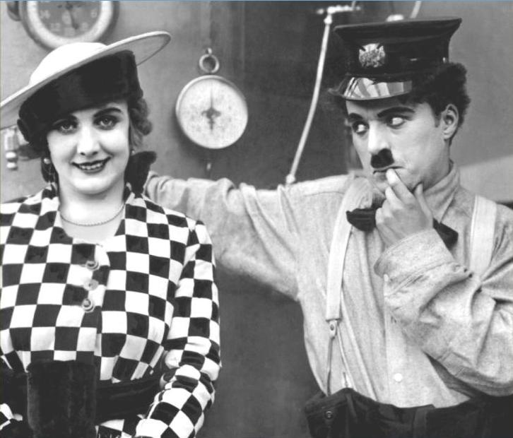 Edna-Purviance-and-Charlie-Chaplin-in-The-Fireman-1916