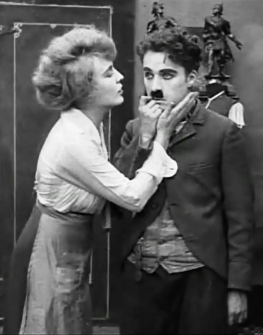 Edna-Purviance-and-Charlie-Chaplin-in-The-Pawnshop-1916-00