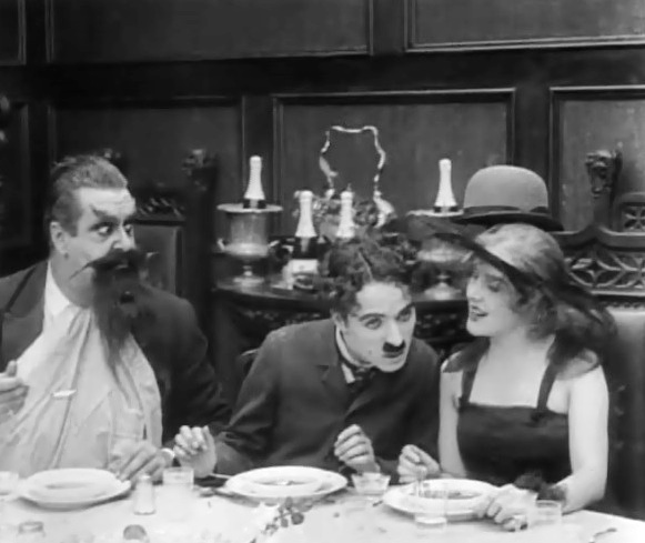 Edna-Purviance-and-Eric-Campbell-and-Charlie-Chaplin-in-The-Count-1916-001
