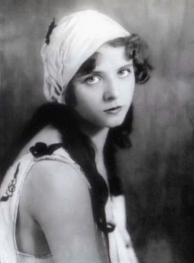 Olive-Thomas-white-cap