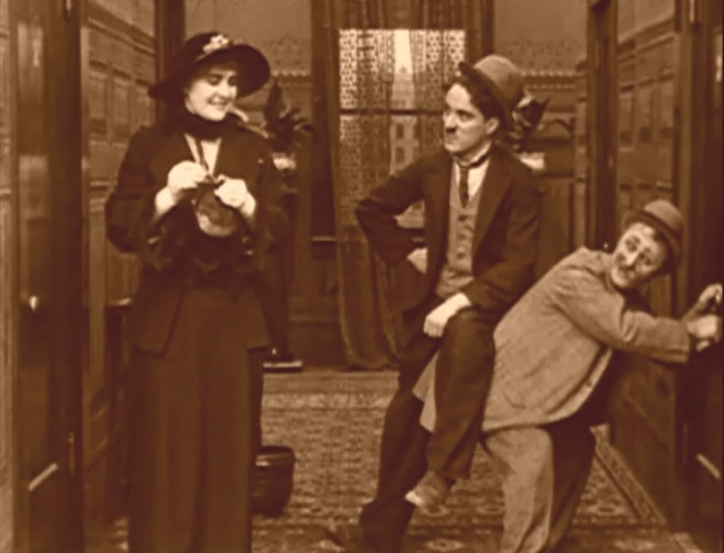 Edna Purviance and Charlie Chaplin and Ben Turpin in A Night Out 1915 2