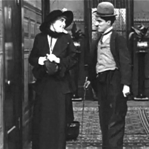 Edna-Purviance-and-Charlie-Chaplin-in-A-Night-Out-1915-00