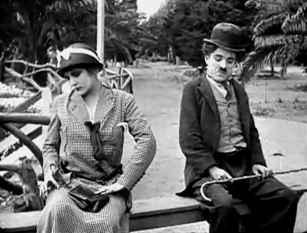 Charlie Chaplin and Edna Purviance in By the Sea 1915 05