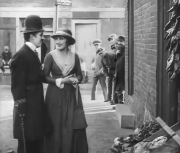 Charlie Chaplin and Edna Purviance in Easy Street 1917 20