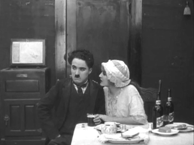 Charlie Chaplin and Edna Purviance in Police 1916 06