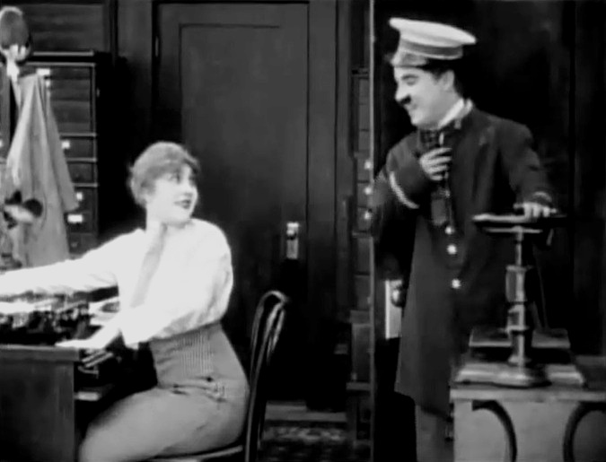 Edna Purviance and Charlie Chaplin in The Bank 1915 004