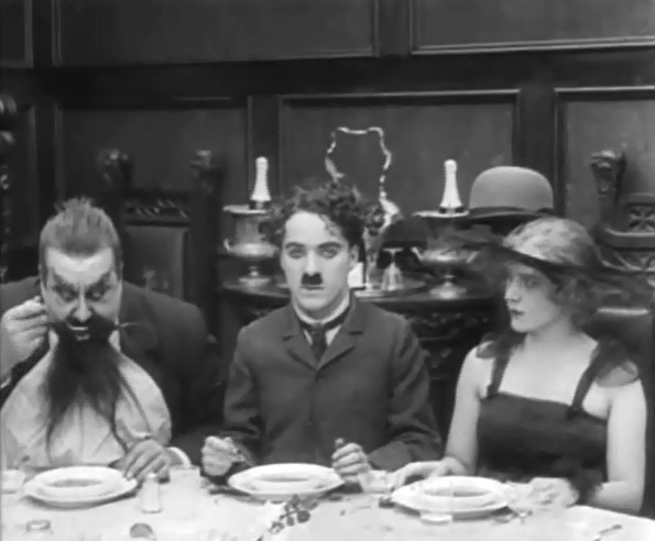 Edna Purviance and Eric Campbell and Charlie Chaplin in The Count 1916 10