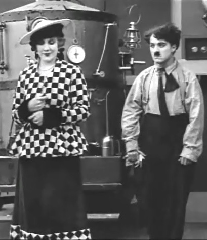 Edna-Purviance-and-Charlie-Chaplin-in-The-Fireman-1916-00