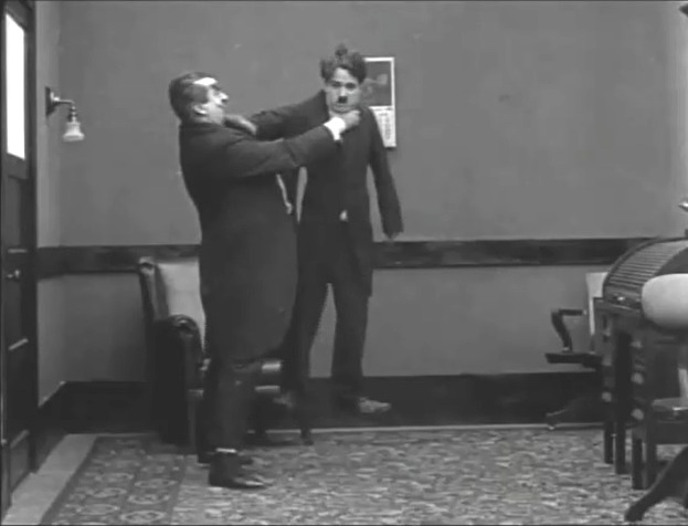 Charlie Chaplin and Eric Campbell in The Floorwalker 1916 18