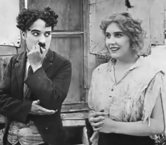 Edna-Purviance-and-Charlie-Chaplin-in-The-Vagabond-1916-00