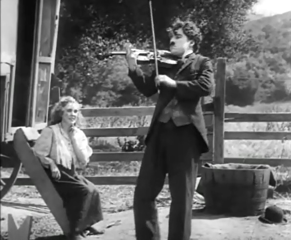 Edna Purviance and Charlie Chaplin in The Vagabond 1916 4