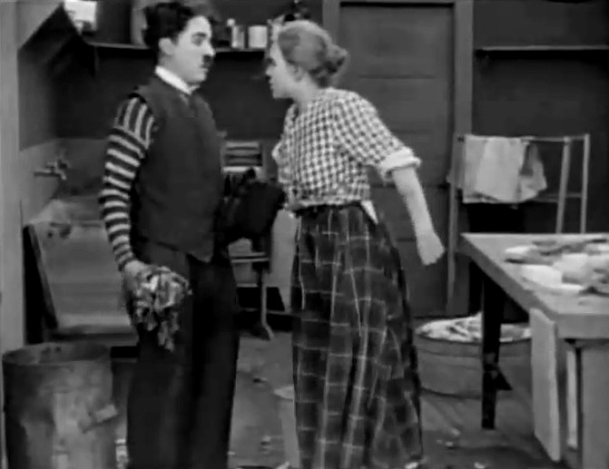 Edna Purviance and Charlie Chaplin in Triple Trouble 1918 10