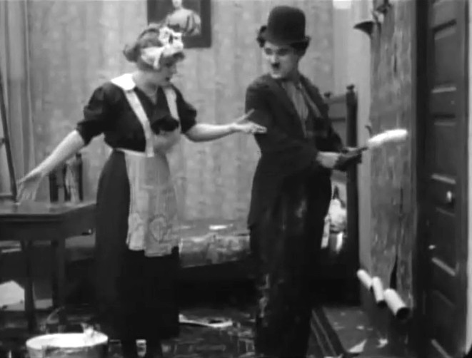 Edna Purviance and Charlie Chaplin in Work 1915 11