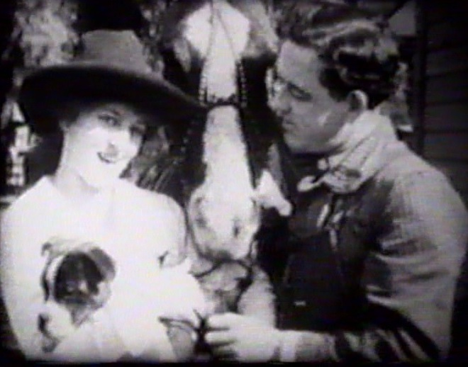 Helen Holmes and Leo Maloney in The Leap from the Water Tower 1915 10