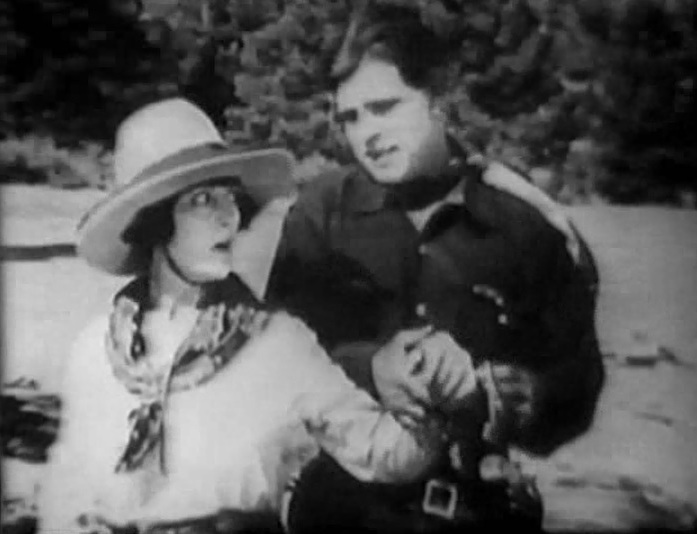 Jack Hoxie and Marin Sais in Riders of the Law 1922 08
