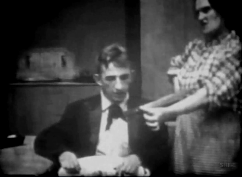 Larry Semon and Nellie Anderson in Slips and Slackers 1917 04