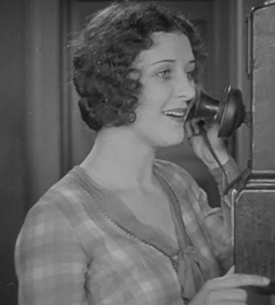 Marceline Day talks on the phone to Buster Keaton