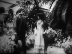 Arthur-V-Johnson-and-Marion-Leonard-in-Love-among-the-Roses-1910-05.jpg
