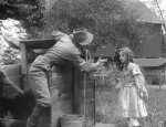 Gladys-Egan-and-Henry-Walthall-in-a-scene-from-In-the-Border-States-1910-director-DW-Griffith-cinematographer-Billy-Bitzer-4.jpg