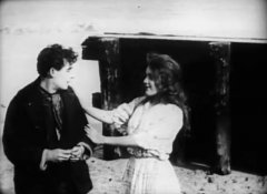 Mary-Pickford-and-Henry-Walthall-in-The-Sorrows-of-the-Unfaithful-1910-3.jpg
