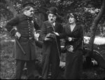 Edna-Purviance-and-Charlie-Chaplin-and-a-cop-and-in-A-Jitney-Elopement-1915-11.jpg