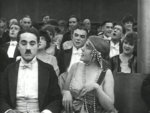 Edna-Purviance-and-Charlie-Chaplin-in-A-Night-in-the-Show-1915-16.jpg
