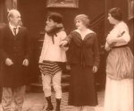 Edna-Purviance-and-Charles-Inslee-Charlie-Chaplin-and-Marta-Golden-in-A-Woman-1915-8.jpg