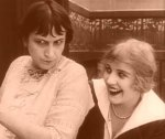 Edna-Purviance-and-Marta-Golden-in-A-Woman-1915-7.jpg