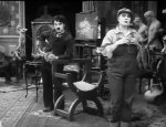 Charlie-Chaplin-and-Edna-Purviance-in-Behind-the-Screen-1916-11.jpg