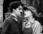 Charlie-Chaplin-and-Edna-Purviance-in-Behind-the-Screen-1916-15.jpg