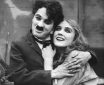 Charlie-Chaplin-and-Edna-Purviance-in-Behind-the-Screen-1916-21.jpg