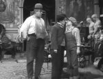 Eric-Campbell-and-Charlie-Chaplin-and-Edna-Purviance-in-Behind-the-Screen-1916-17.jpg