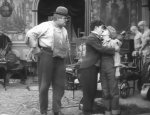 Eric-Campbell-and-Charlie-Chaplin-and-Edna-Purviance-in-Behind-the-Screen-1916-18.jpg