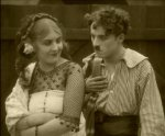Charlie-Chaplin-and-Edna-Purviance-in-Burlesque-on-Carmen-1915-18.jpg