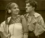 Charlie-Chaplin-and-Edna-Purviance-in-Burlesque-on-Carmen-1915-19.jpg