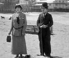 Charlie-Chaplin-and-Edna-Purviance-in-By-the-Sea-1915-02.jpg