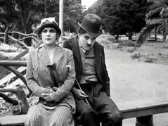 Charlie-Chaplin-and-Edna-Purviance-in-By-the-Sea-1915-06.jpg