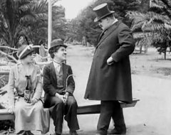 Edna-Purviance-and-Charlie-Chaplin-and-Bud-Jamison-in-By-the-Sea-1915-05.jpg
