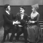 Albert_Austin-and-Charlie-Chaplin-and-Edna-Purviance-in-Easy-Street-1917-4.jpg