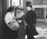Charlie-Chaplin-and-Edna-Purviance-in-Easy-Street-1917-19.jpg
