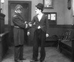 Charlie-Chaplin-in-Easy-Street-1917-8.jpg