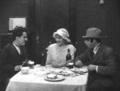 Charlie-Chaplin-and-Edna-Purviance-and-Wesley-Ruggles-in-Police-1916-03.jpg