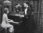 Edna-Purviance-and-Charlie-Chaplin-in-The-Adventurer-1917-10.jpg