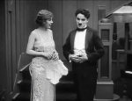 Edna-Purviance-and-Charlie-Chaplin-in-The-Adventurer-1917-13.jpg