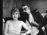 Edna-Purviance-and-Eric-Campbell-in-The-Adventurer-1917-6.jpg