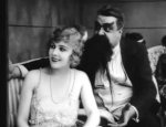 Edna-Purviance-and-Eric-Campbell-in-The-Adventurer-1917-8.jpg